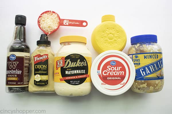 ingredients for dressing on a white board.