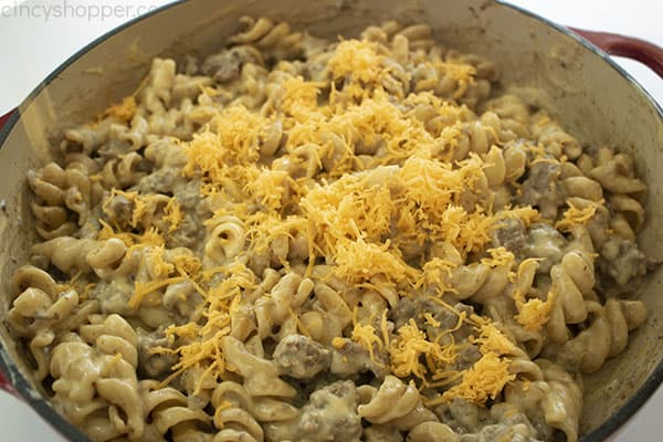 Mixed Cheeseburger Hamburger Helper topped with shredded sharp cheddar cheese