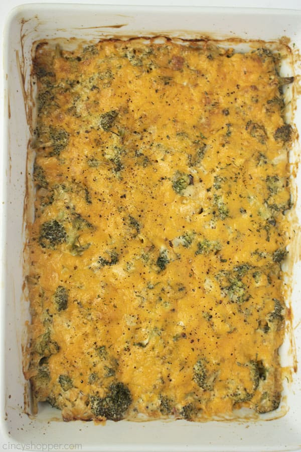 Broccoli Casserole with cheese in a white baking dish