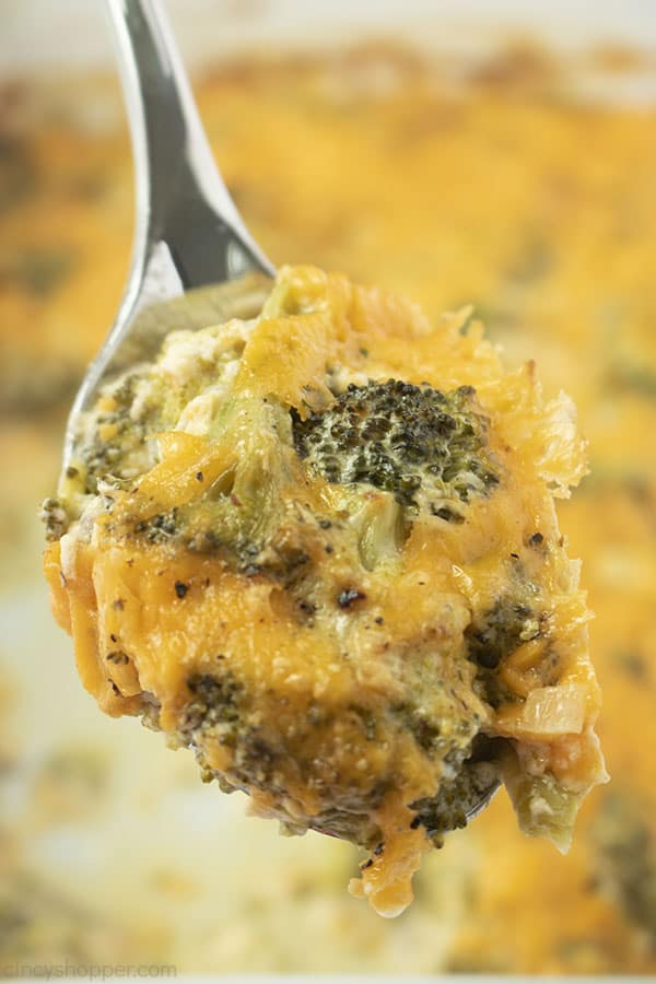 Lifted spoon with broccoli cheese casserole