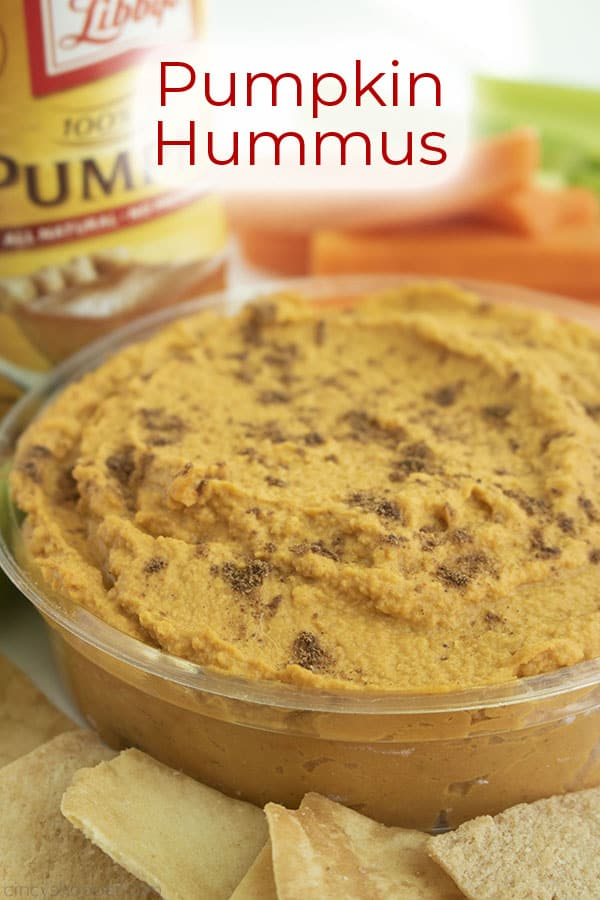 Text on image Pumpkin Hummus a clear dish with carrots, celery, pita chips and canned pumpkin.
