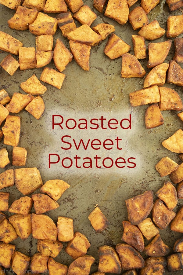 Text in middle of image Roasted Sweet Potatoes on a sheet pan.