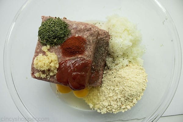 Classic Meatloaf ingredients in a large clear bowl.