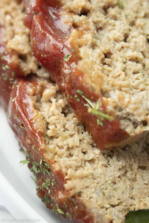 Closeup of traditional meatloaf with ketchup glaze closeup.