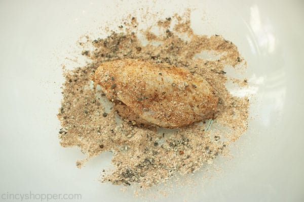 Chicken wing in clear bowl with rub