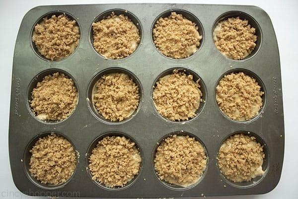 Prepared crumb muffins in a pan