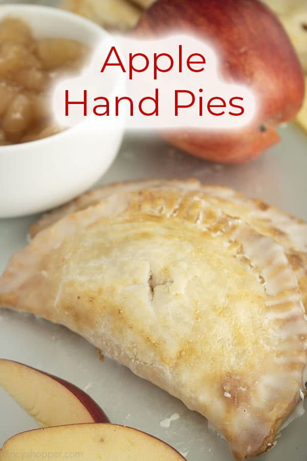 Text on image Apple Hand Pies on a pan with apple slices, red apple and bowl of apple pie filling.