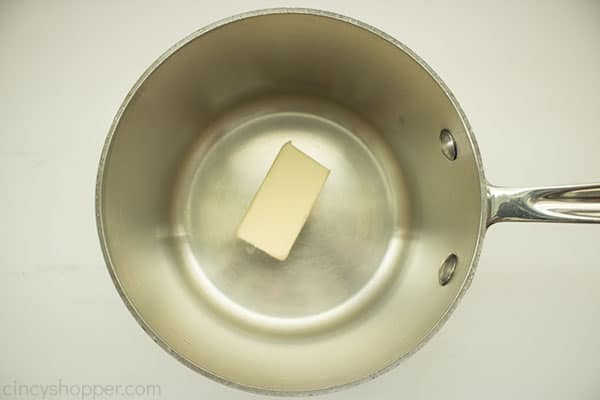 Butter in a small saucepan with white background
