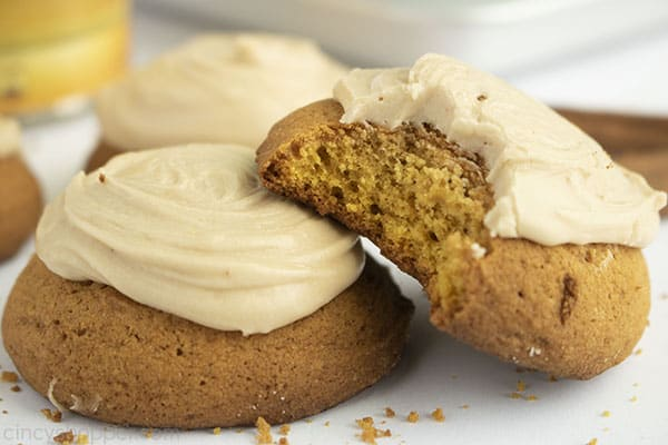 Image with two Pumpkin Cookies with brown butter frosting on a white background