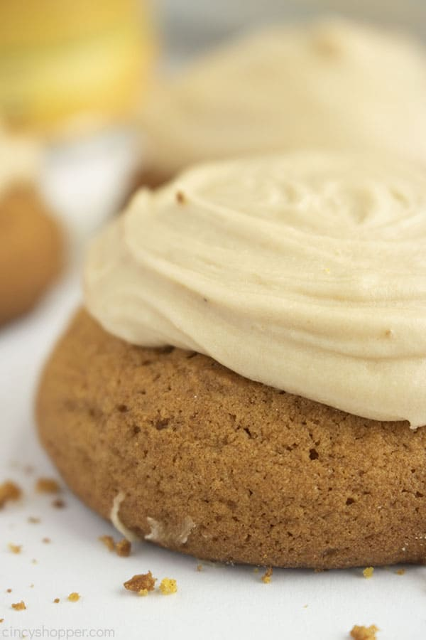 Closeup of Pumpkin Cookies with brown butter frosting on a white background