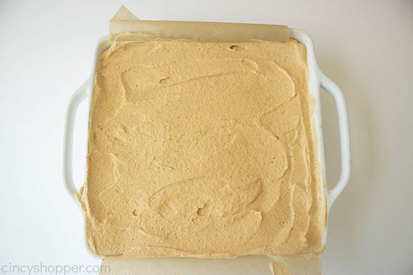 Overhead photo of the finished Pumpkin Icebox Cake before freezing in a square white pan