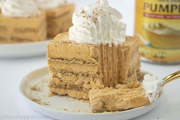 Close up shot of a plated slice of No Bake Pumpkin Icebox Cake with a silver fork