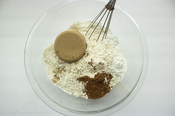 Streusel ingredients in a clear bowl with whisk