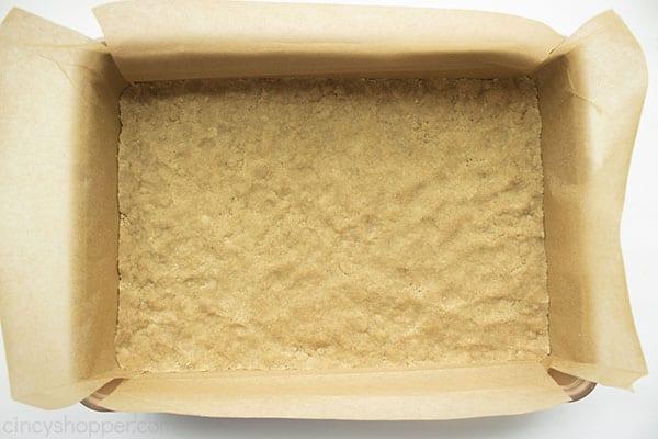 Pumpkin bar crust in parchment lined baking pan