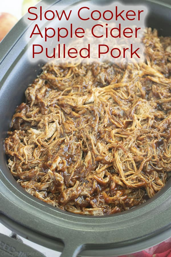 Long pin image of the Pulled Pork in a black oval slow cooker titled Slow Cooker Apple Cider Pulled Pork in red