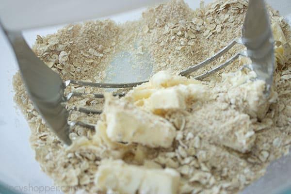 Butter added to oat topping for crisp