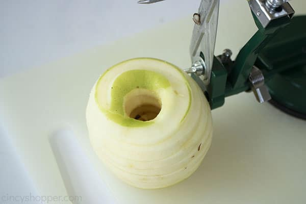 Peeled, cored and sliced green apple