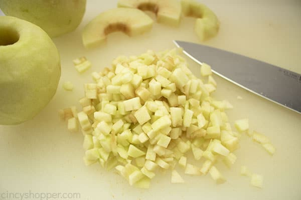Diced apples on cutting board for cake.