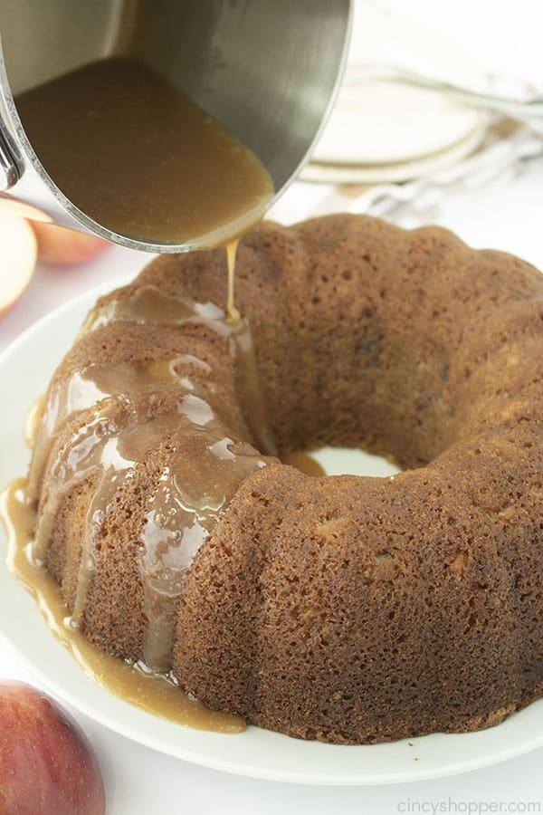 Glaze poured on baked apple cake.