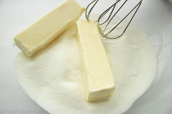 Butter and sugar added to clear mixing bowl with beaters.