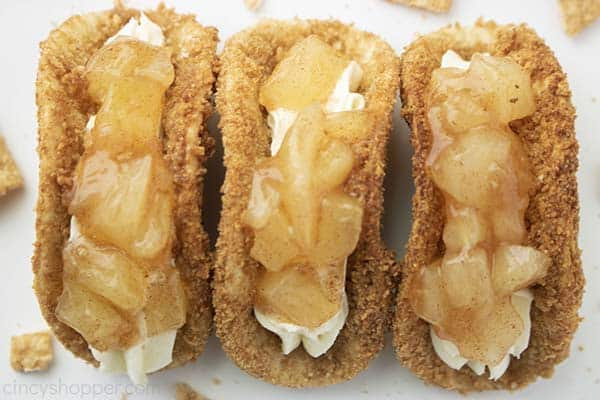 Three finished Apple Cheesecake Tacos