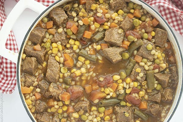 Fully cooked Beef Barley Soup in a dutch oven