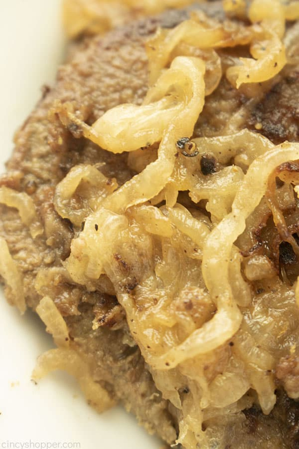 Overhead closeup of liver smothered in onions.