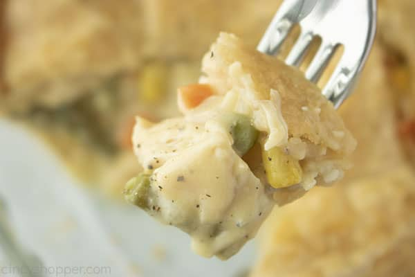 Baked chicken pot pie on a fork.
