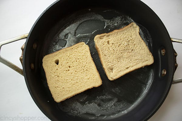 Two slices of French Toast in a frying pan