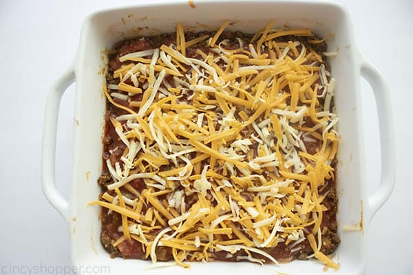 Shredded cheeses added to top of Picante sauce layer