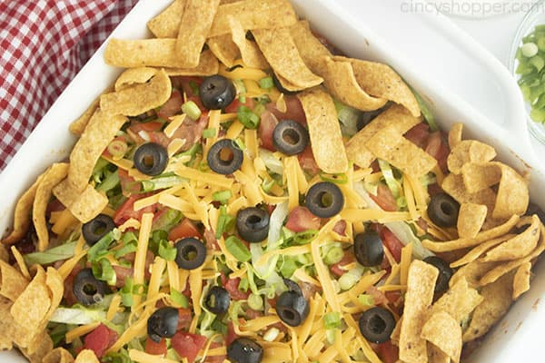 Chips and toppings added to taco casserole