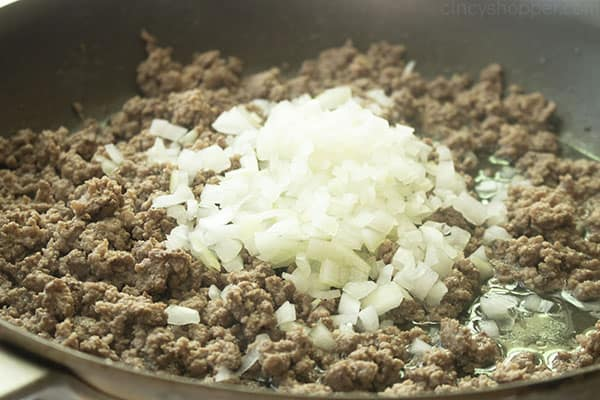 Ground beef and onion cooking in a pan