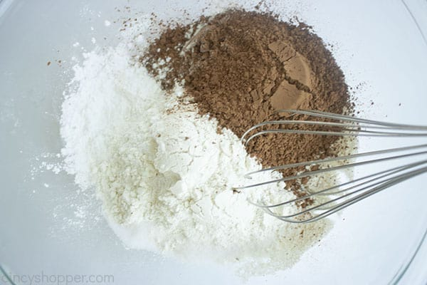 Dry ingredients in a bowl with whisk
