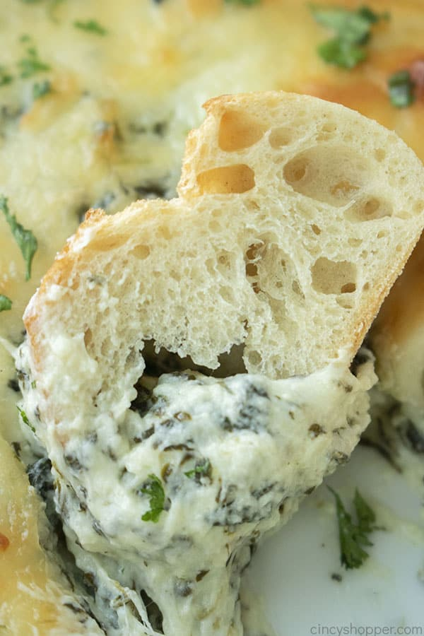 Warm Spinach Dip on a piece of bread