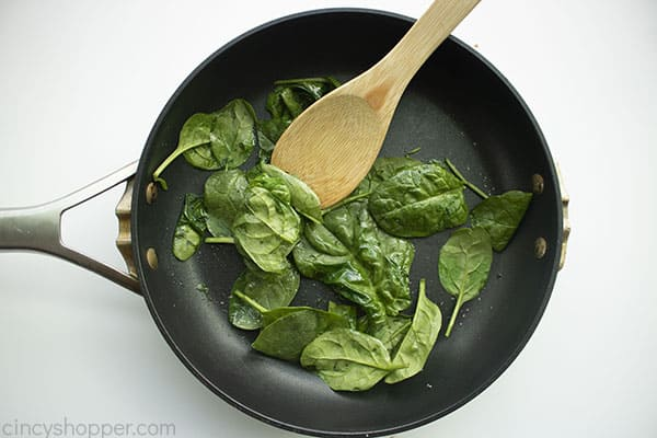 Cooking spinach in a pan