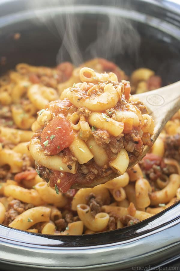 Goulash on a wooden spoon made in slow cooker
