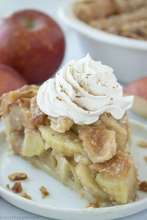 Traditional Apple Pie with lattice crust topping and whipped cream