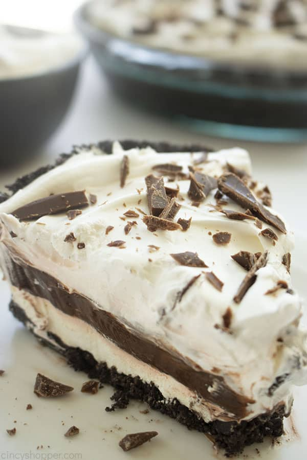Triple Layer Chocolate Cream pie slice on a plate