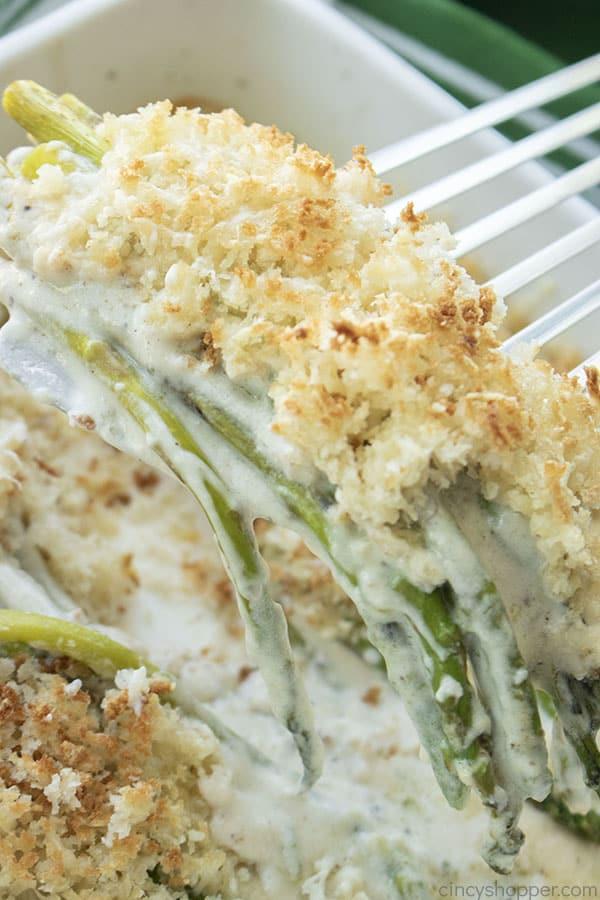 Parmesan Asparagus Casserole on a spatula.