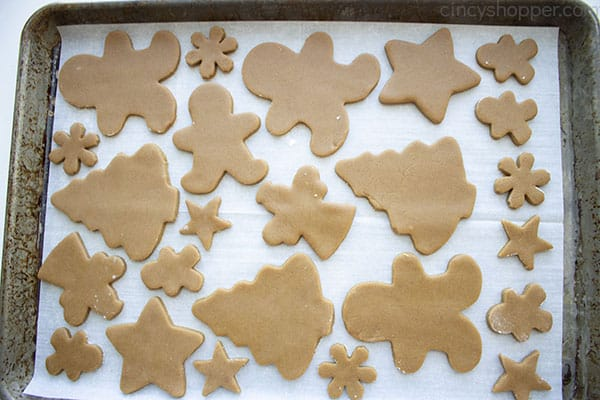 Cutout gingerbread cookies on a cookie sheet