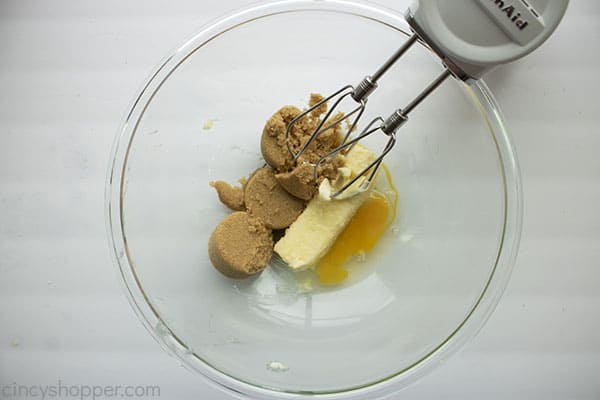 Sugar butter and egg in bowl for cookie dough