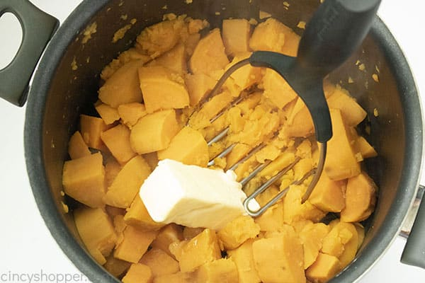 Adding butter to sweet potatoes