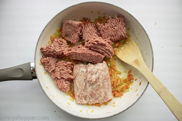 Meat added to pan