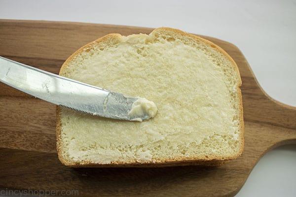 Butter spread on bread slice