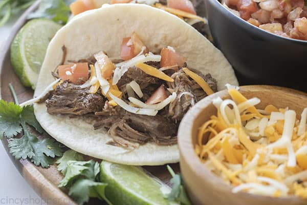 Beef Barbacoa tacos with toppings
