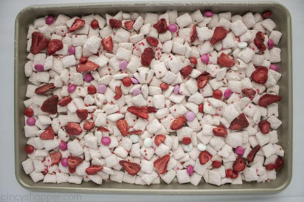 Strawberry Puppy Chow on sheet pan