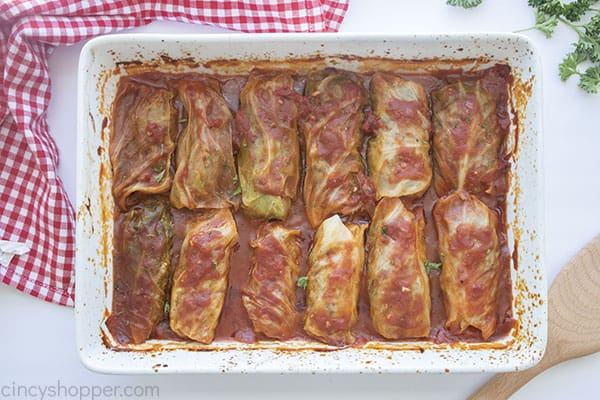 Baked cabbage rolls in a white baking dish