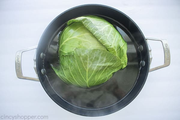 Cabbage head in pot with water for boiling