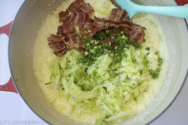 Bacon, cabbage and green onions added to potatoes