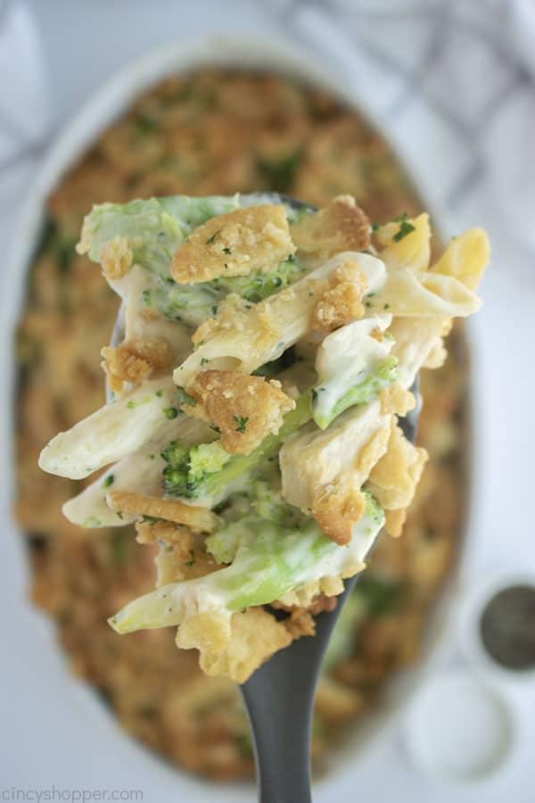 Alfredo Chicken Broccoli Casserole on a spoon